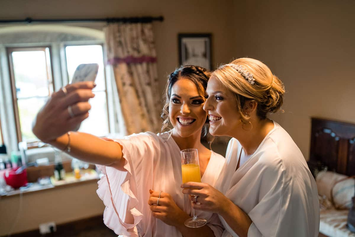 bride and bridesmaid having a selfie together