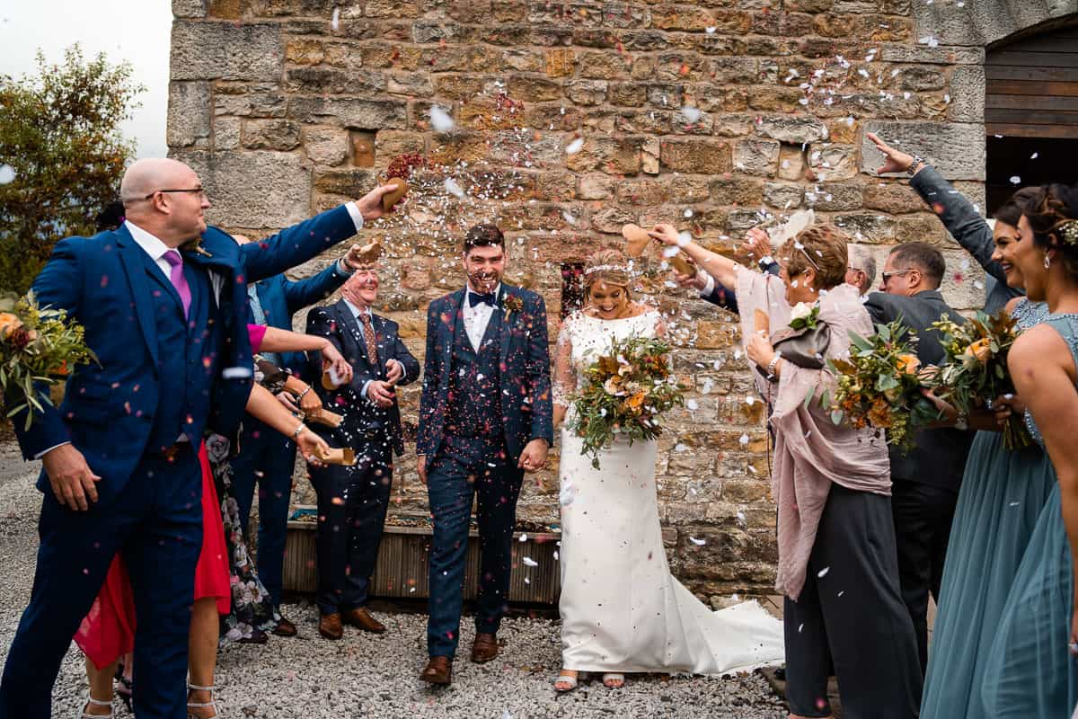 bride and groom confetti shot at the outbarn wedding venue