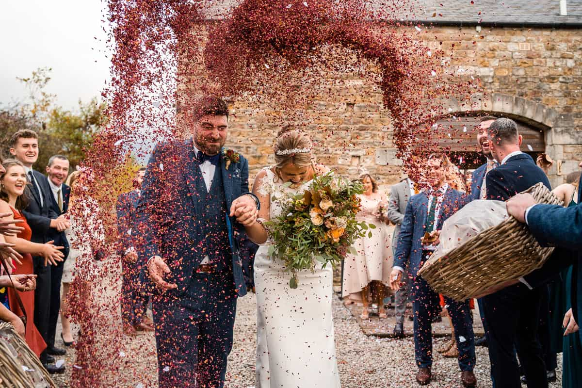 couple having whole basket of confetti thrown over them