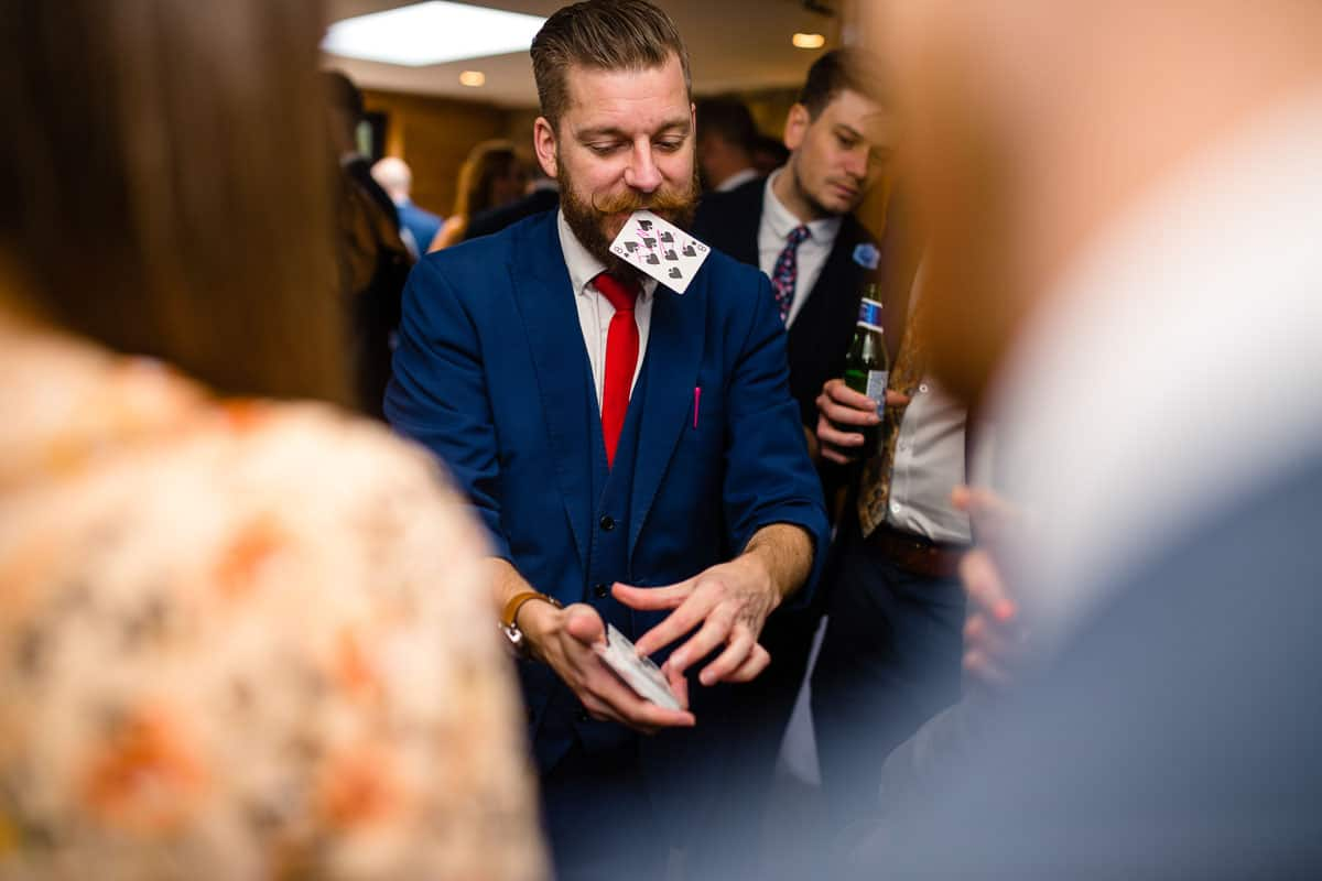 magician performing tricks to wedding guests