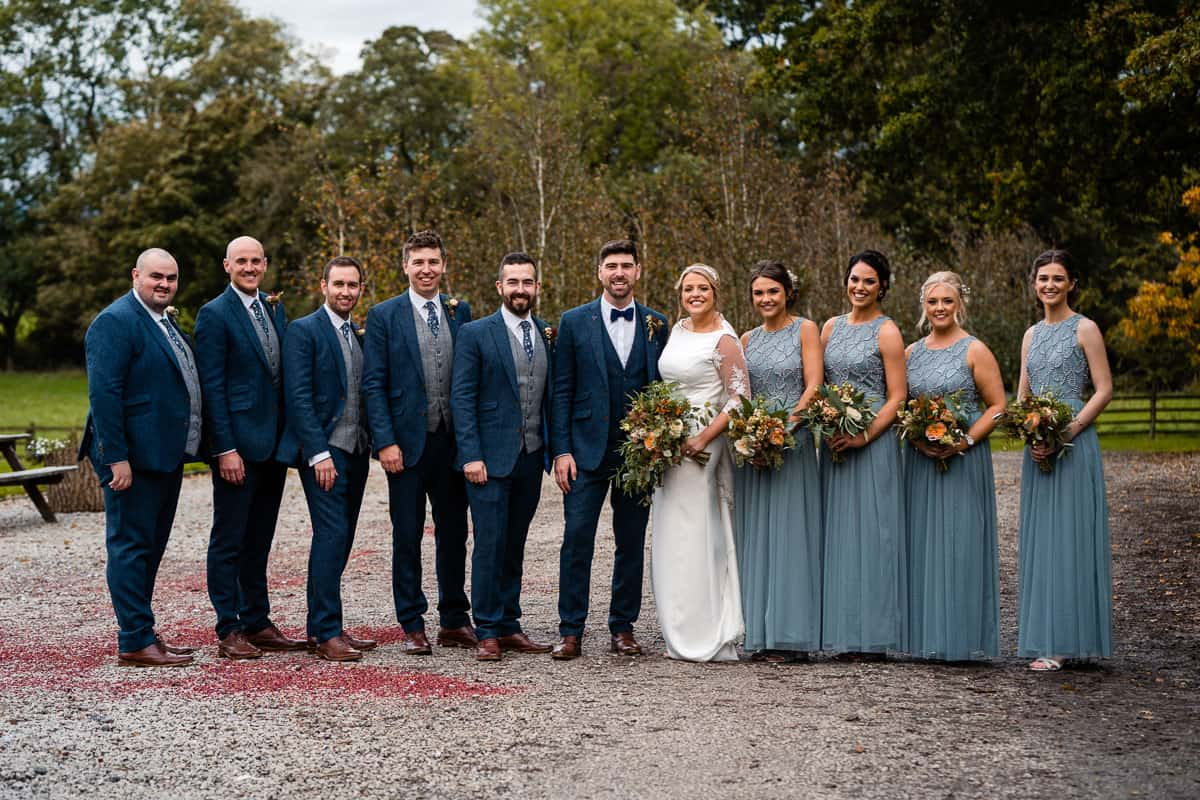 groomsmen and bridesmaids photograph at the outbarn