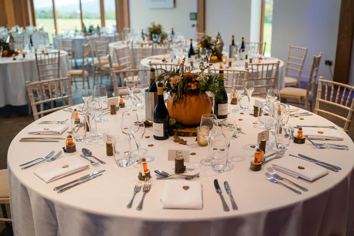 full shot of table decoration with pumpkin centre piece
