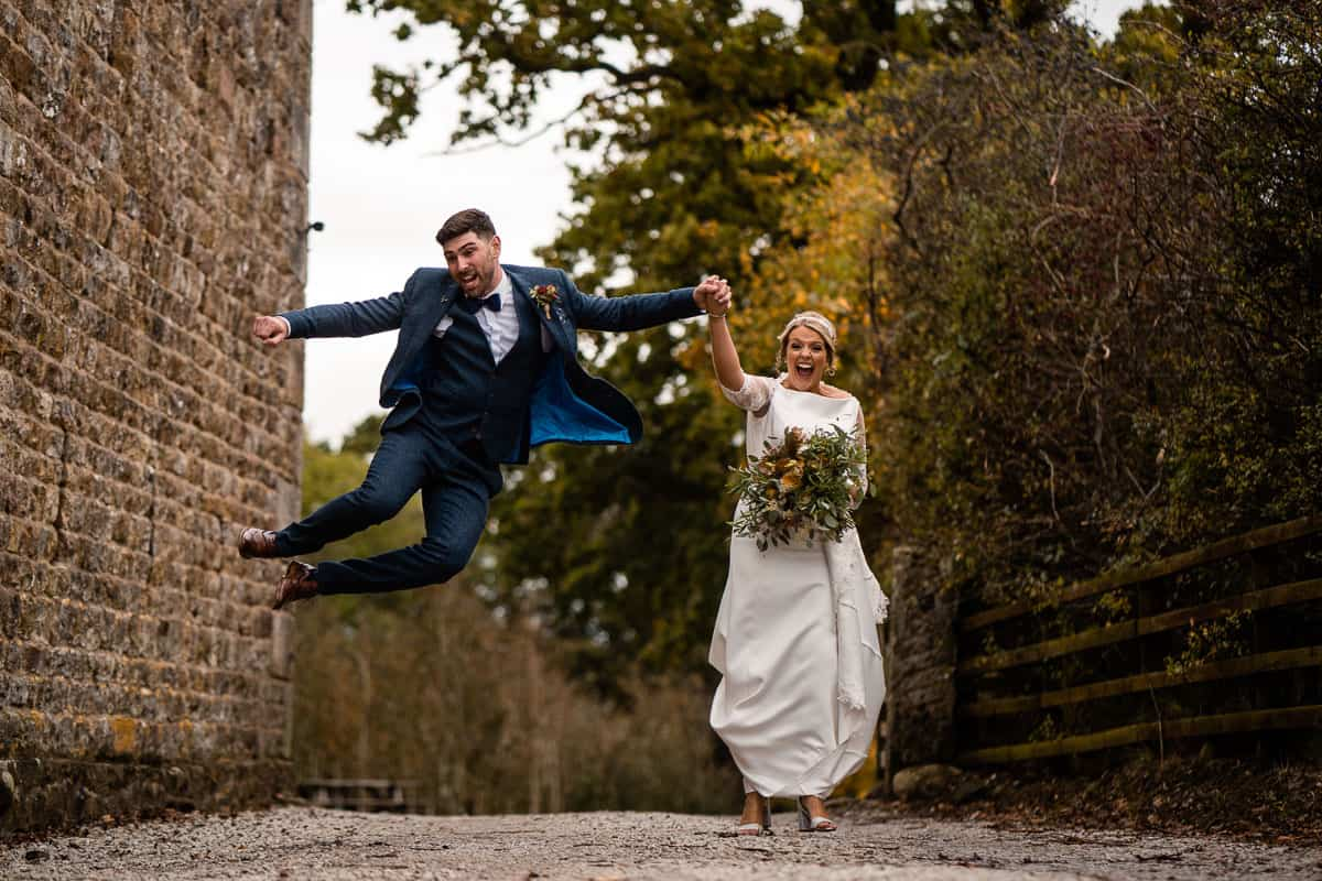 groom jumping in there air after getting married