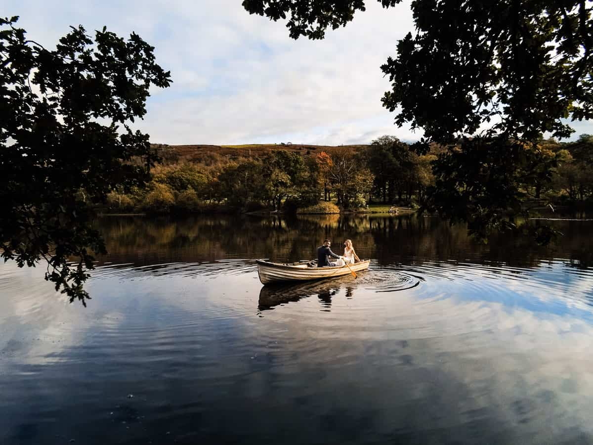 drone photograph of bride and groom in rowing boat at Wyresdale Park