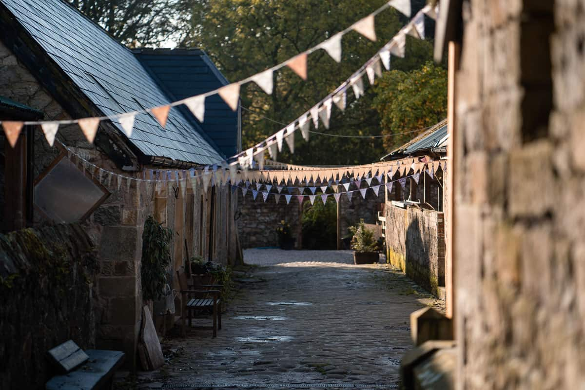 cobbled street with bunting at Wyresdale Park