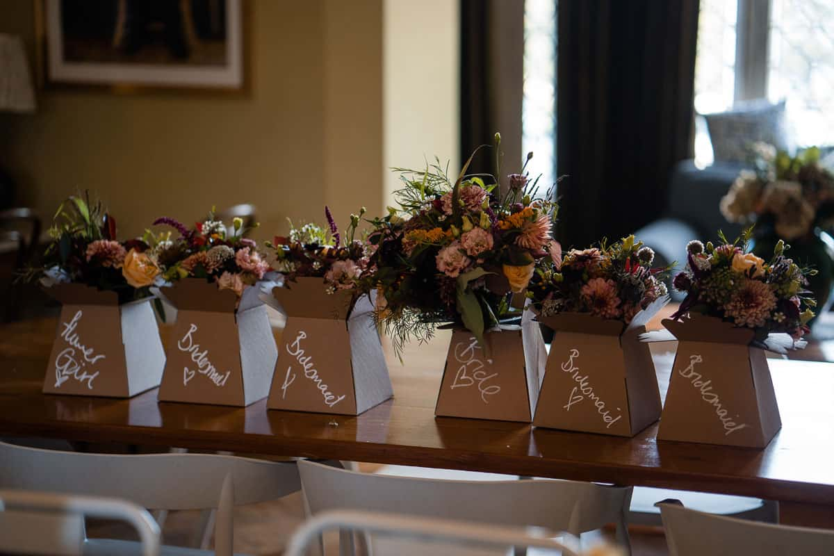 bride and bridesmaid bouquets in a line on the table