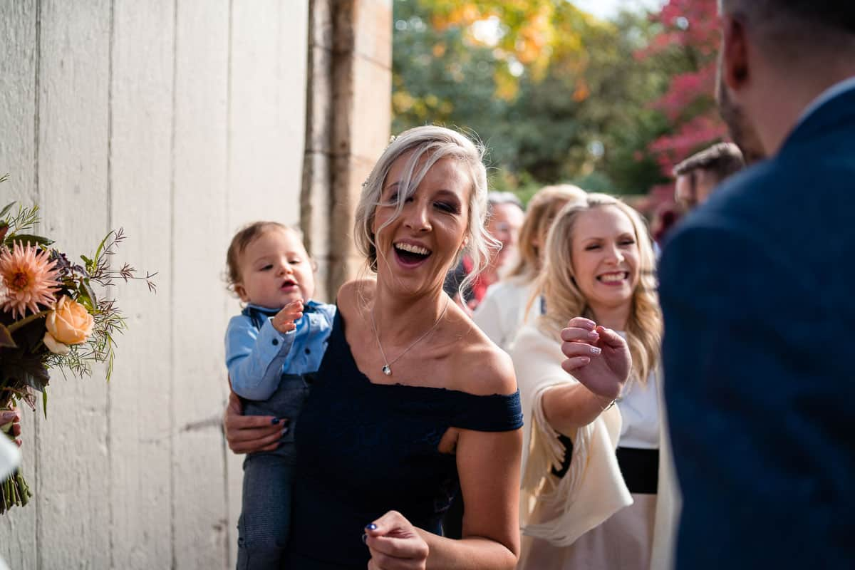wedding guests smiling with baby