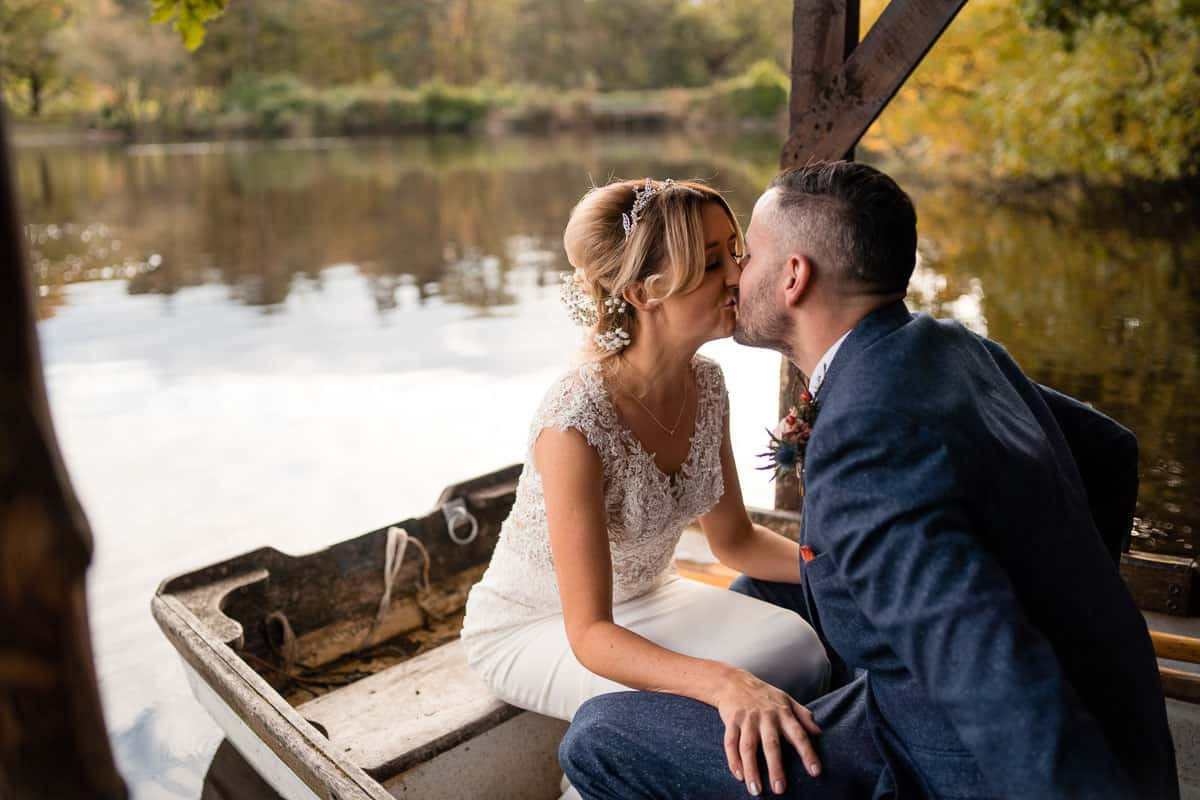 couple kissing in rowing boat