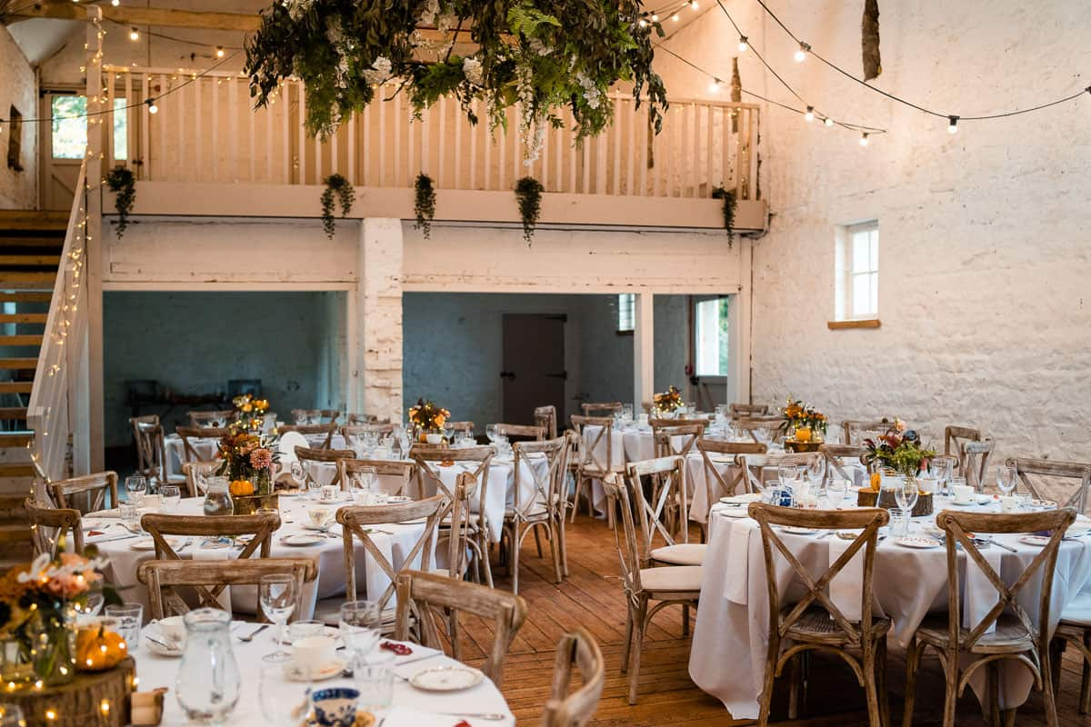 wide view of the barn set up with Autumn theme for reception meal at Wyresdale Park