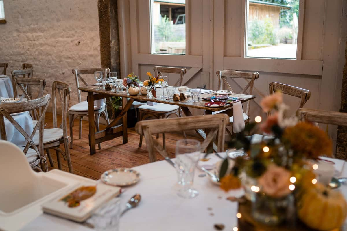 top table decoration with oak chairs and autumn details