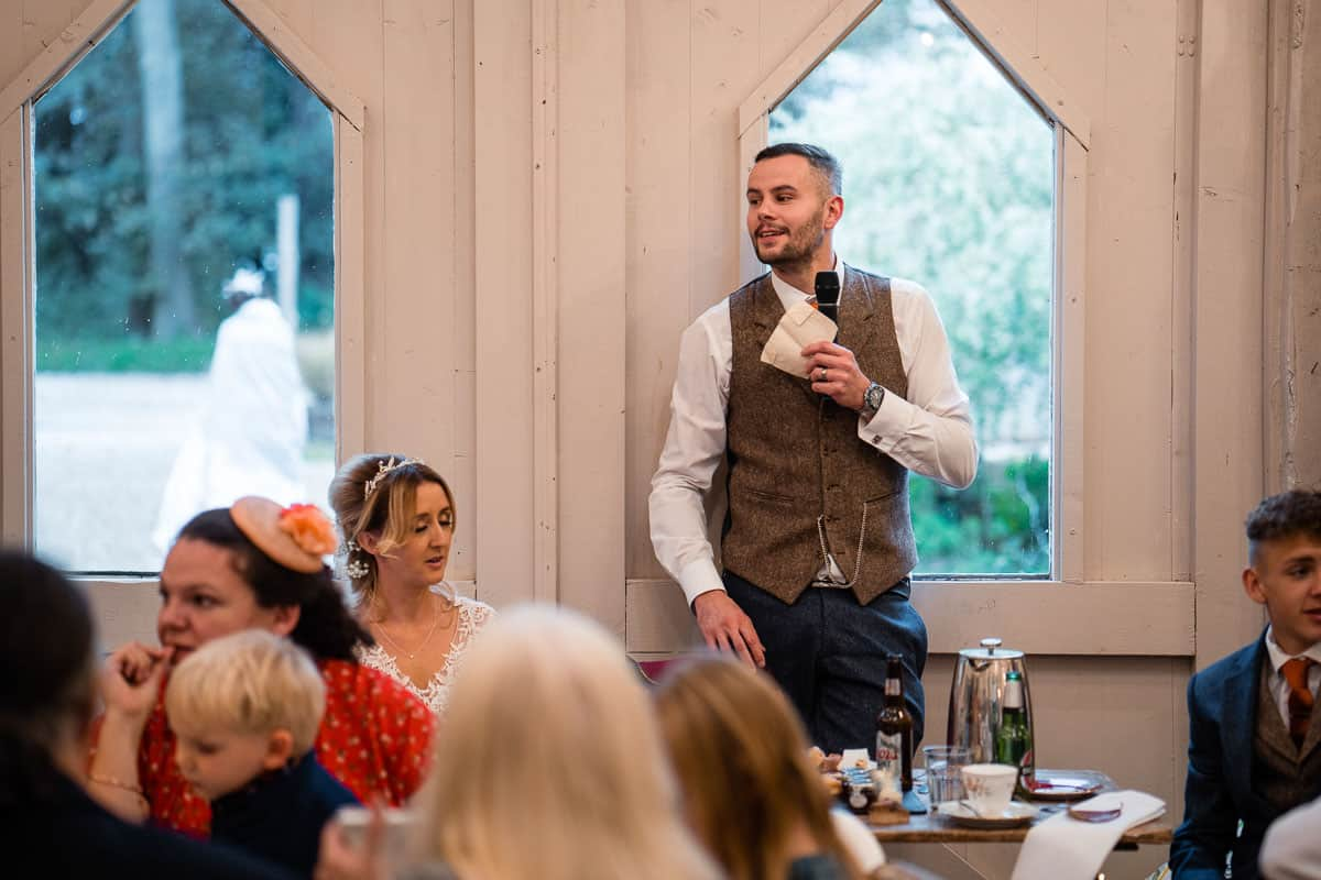 groom stood up behind the top table to do speech