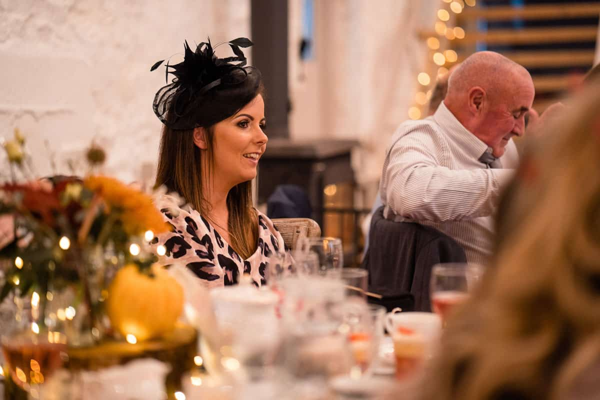 wedding guest sat at table with centre decoration in view
