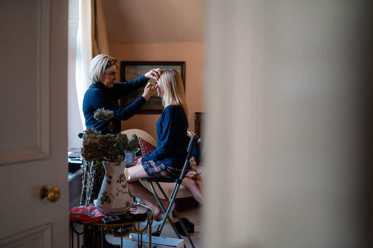 bride having make-up applied by Emma Askew