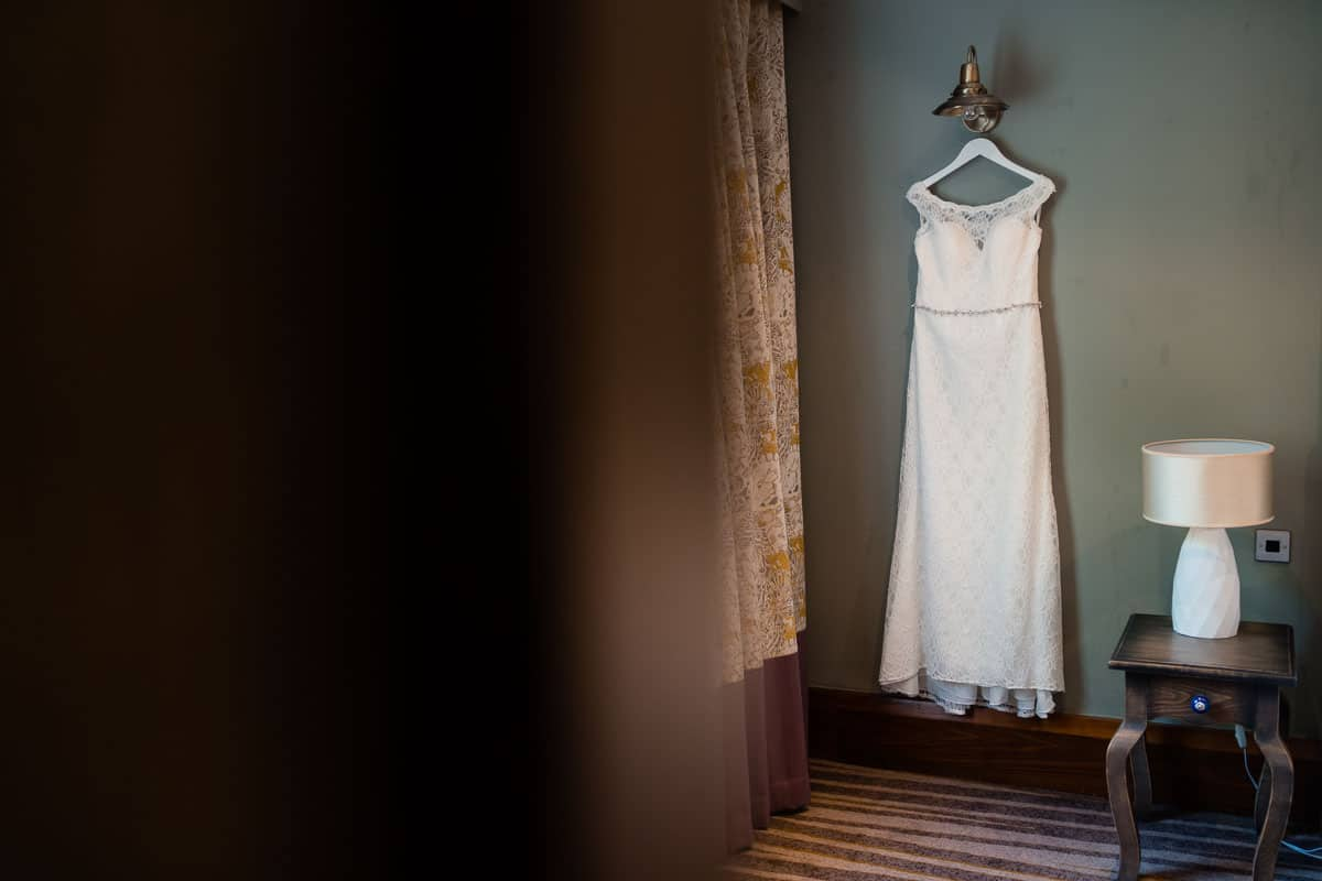wedding dress hanging in hotel room