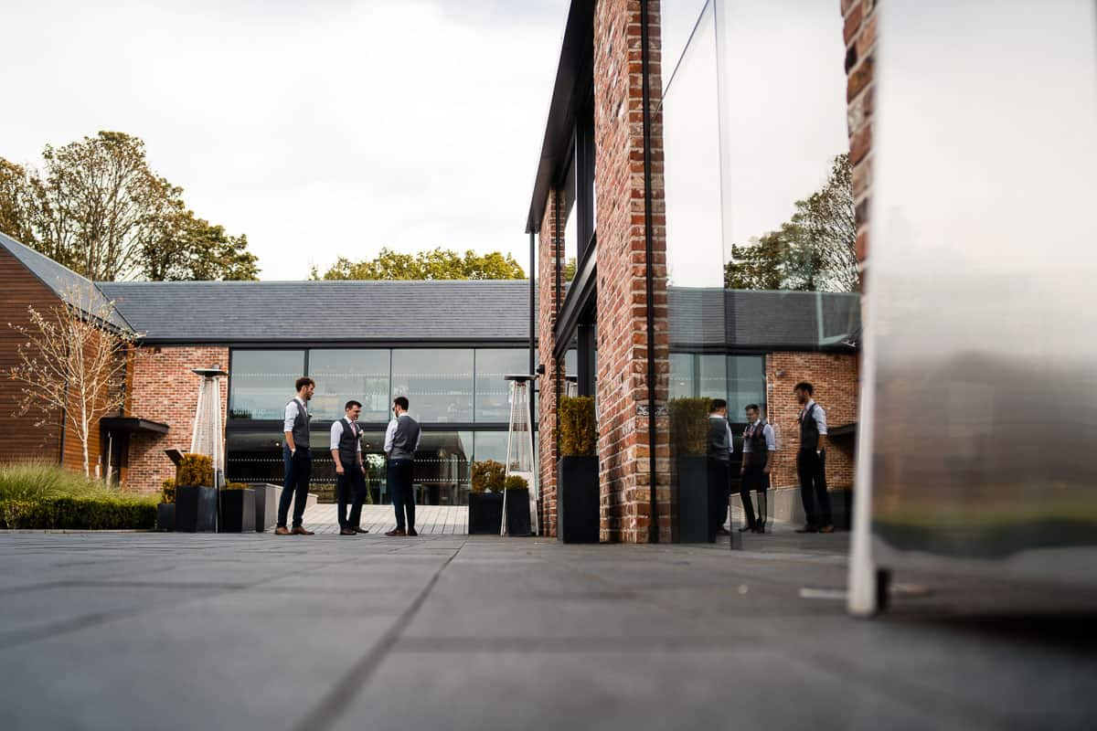 groomsmen waiting outside the colony hq in wilmslow
