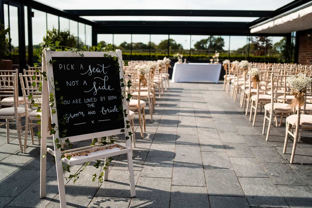 wedding ceremony with the roof open at the colony hq