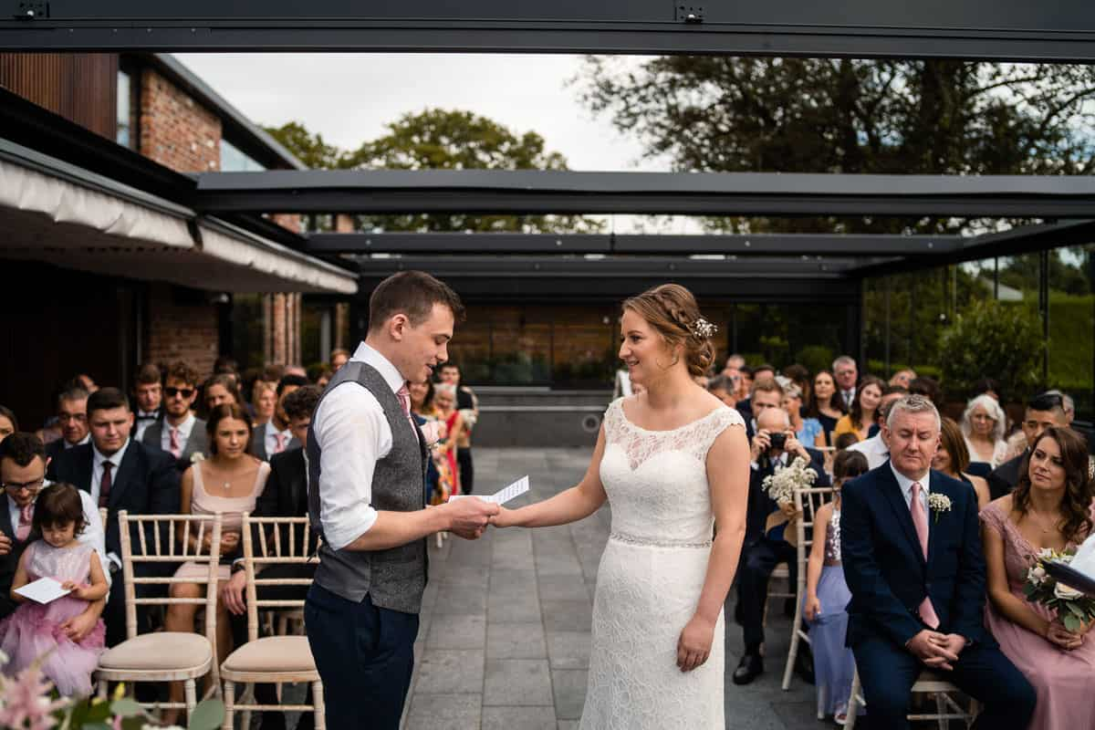 groom reading personalised vows in the ceremony