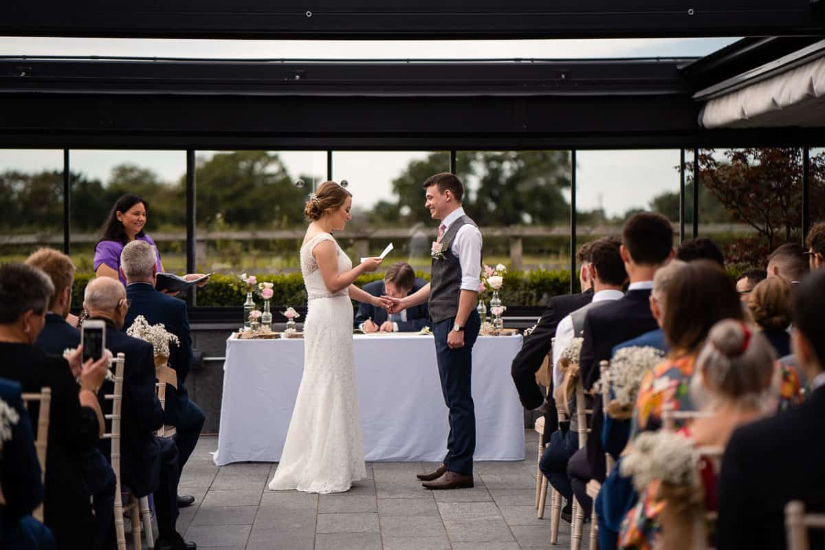 bride reading personal vows in ceremony
