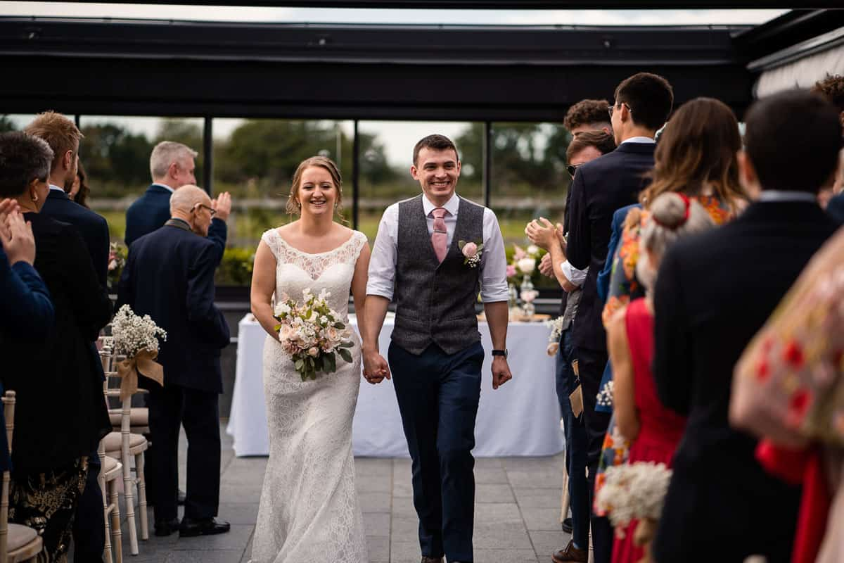 couple walking down the aisle after the ceremony as a married couple