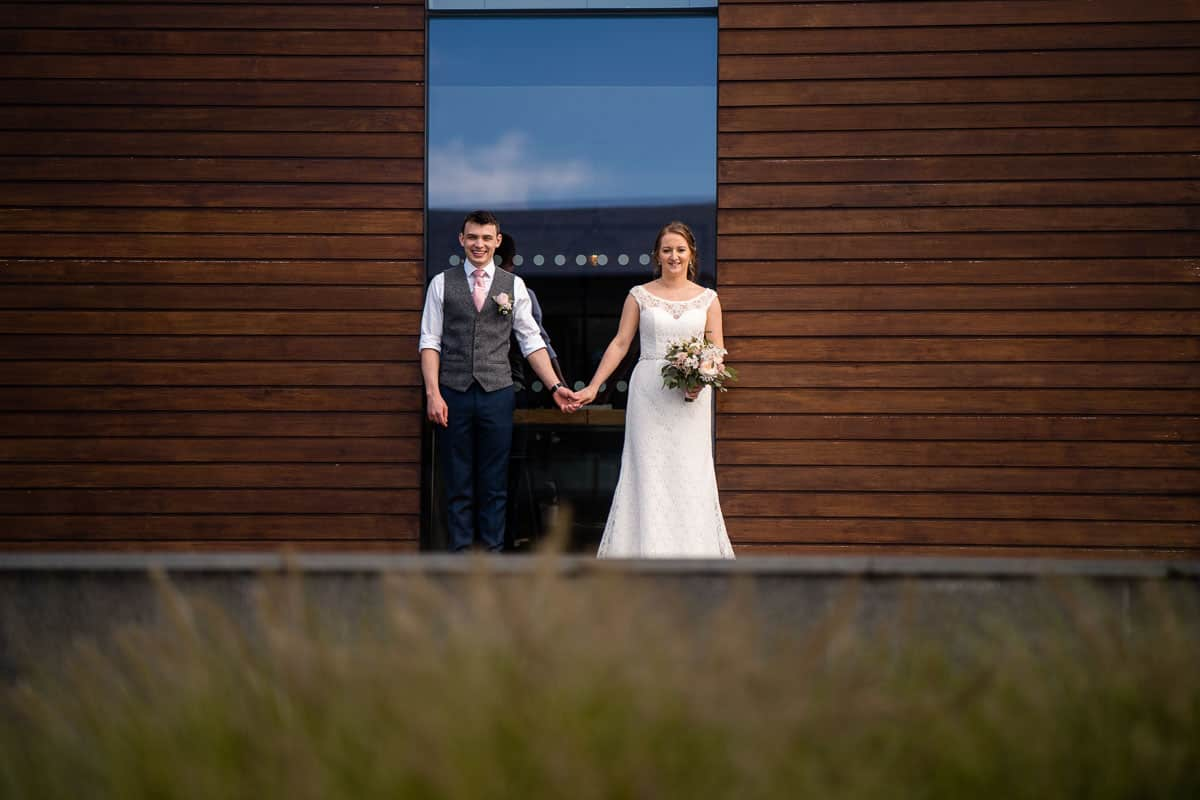 Wedding couple in front of the colony hq