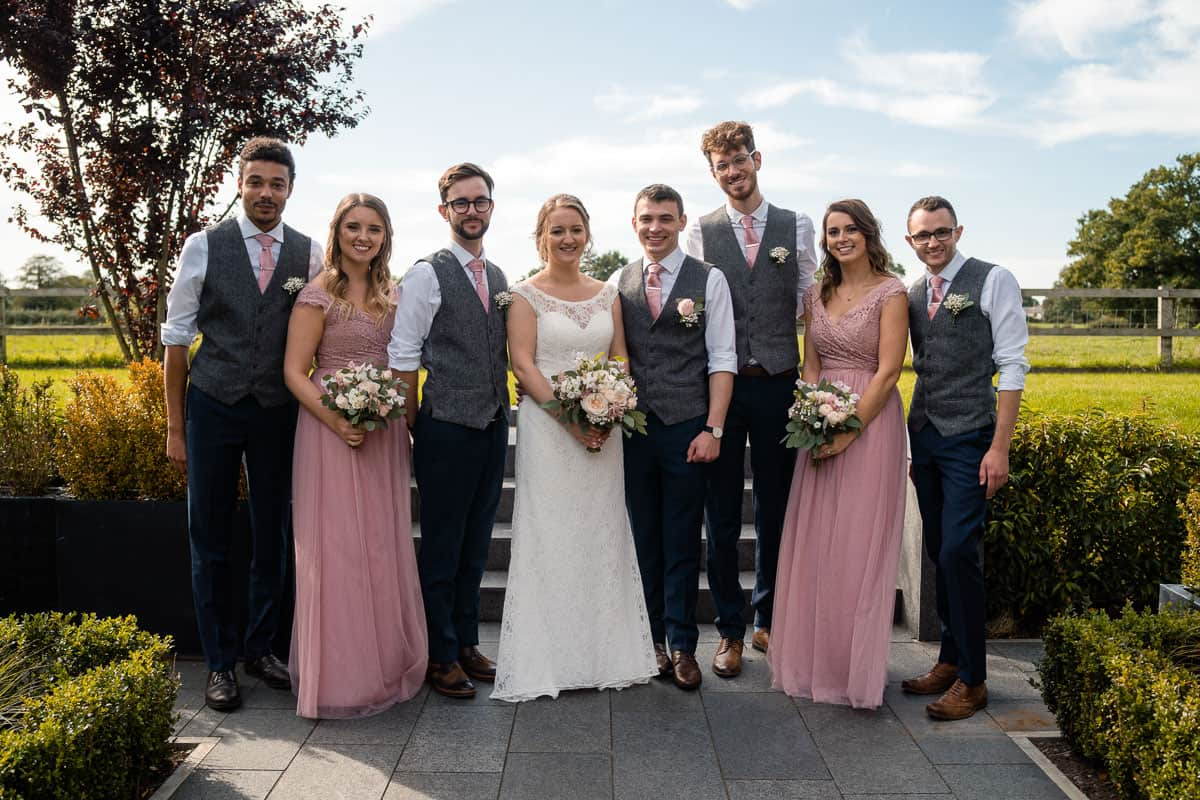 group photo with couple and bridesmaids and groomsmen