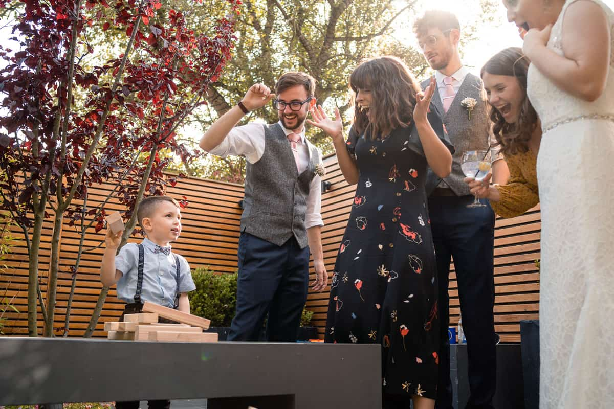 wedding guests outside with jenga