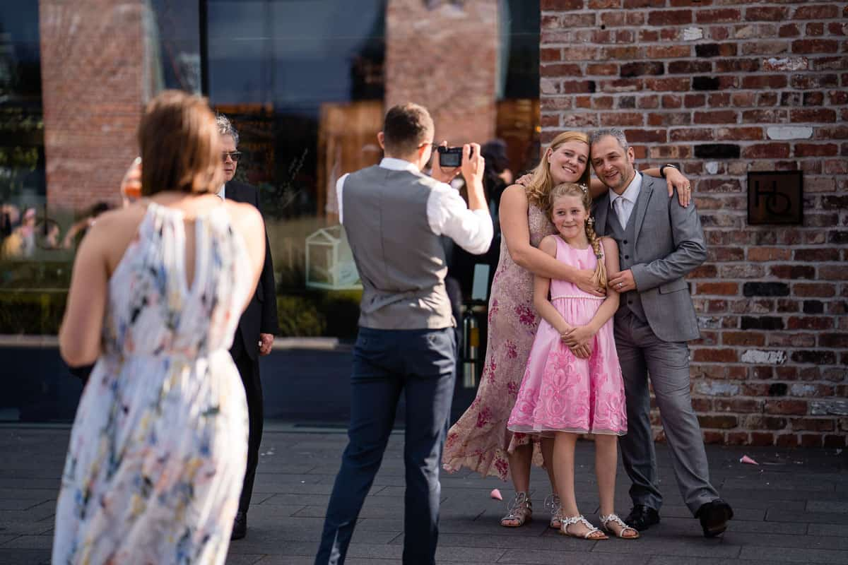 wedding guests posing for photo