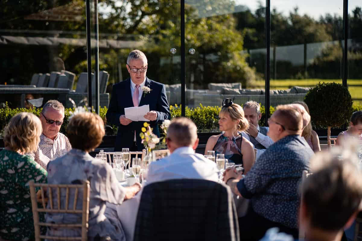 brides dad doing wedding speech