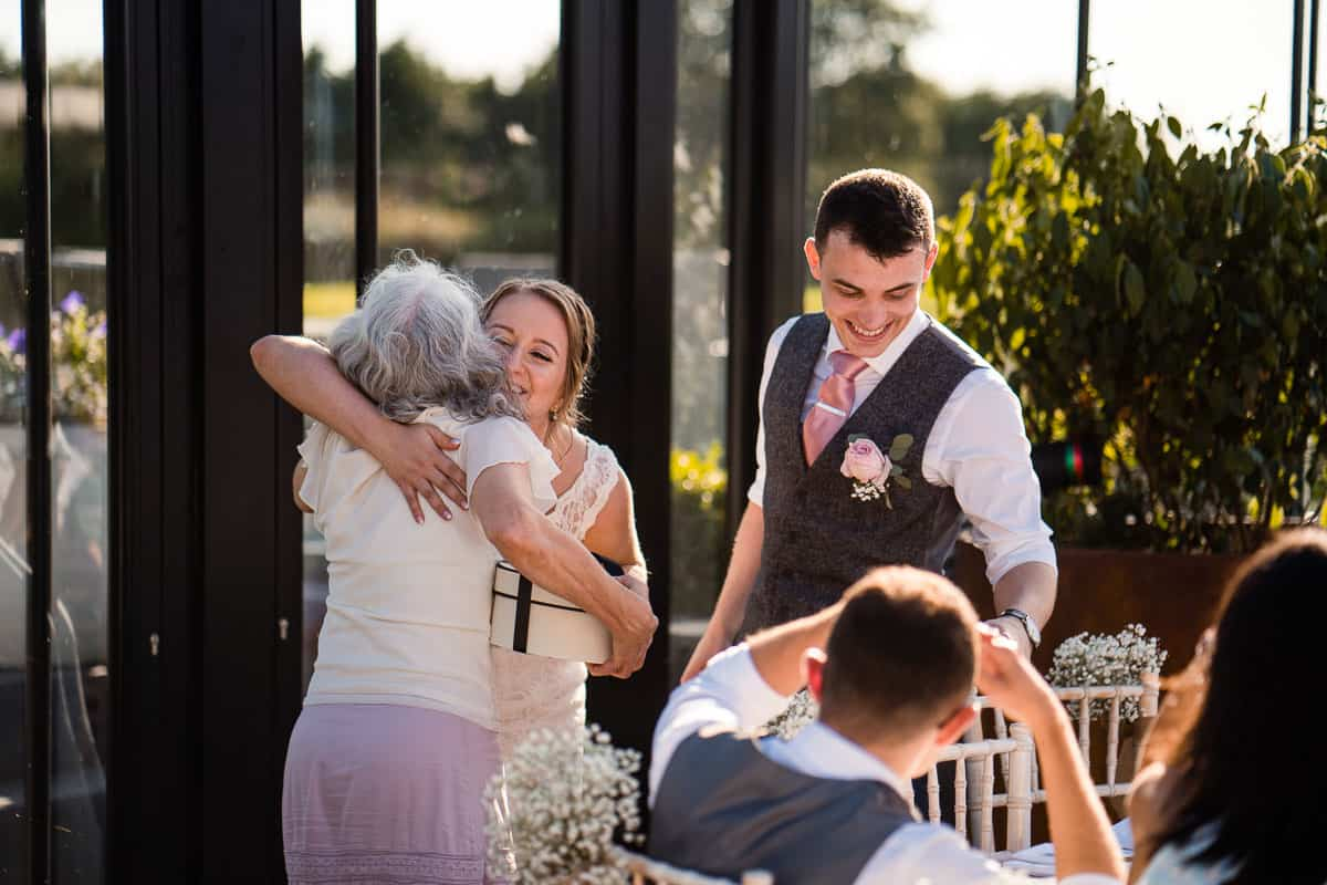 bride giving parent a hug