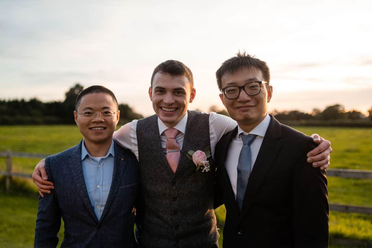 groom with two friends