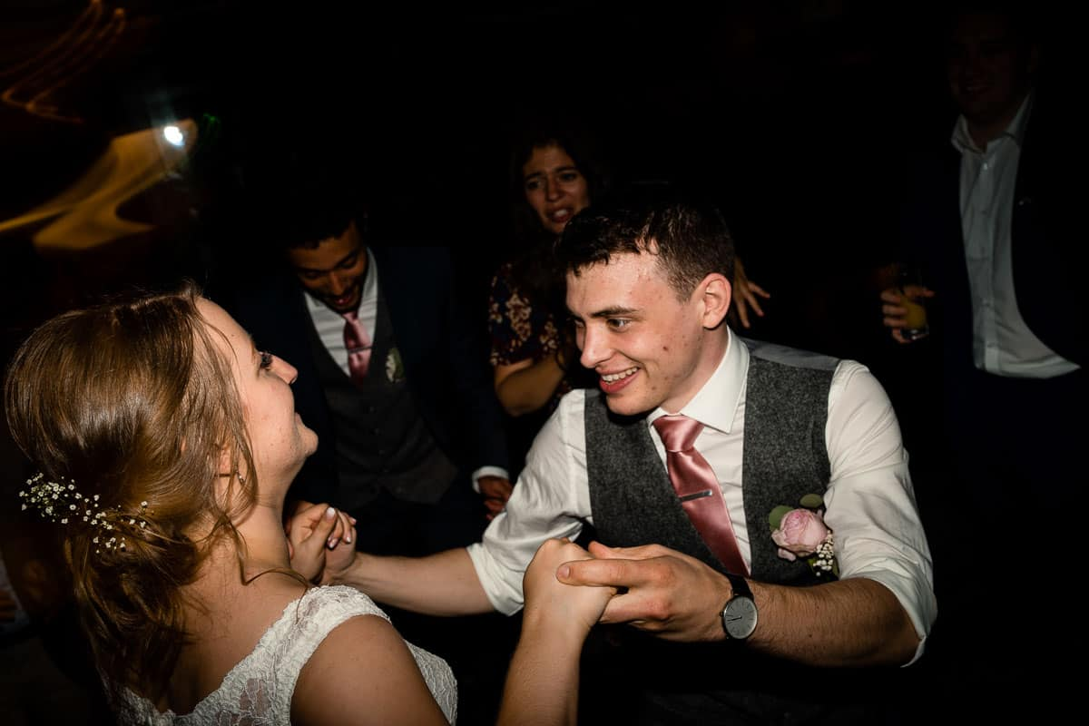 bride and groom dancing at the end of night